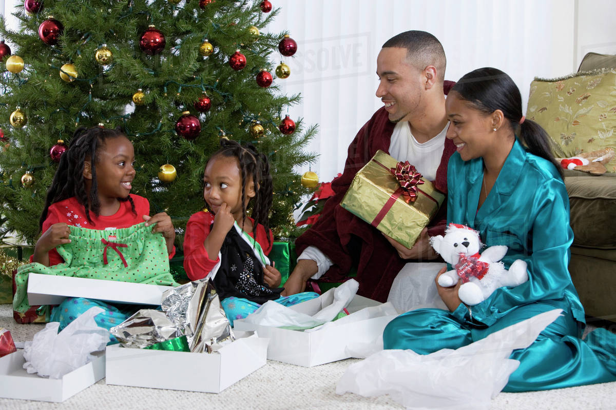African family opening Christmas gifts - Stock Photo - Dissolve