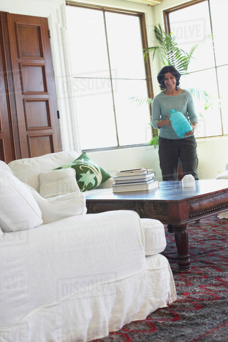 Confident Middle Eastern woman in living room D145_157_335