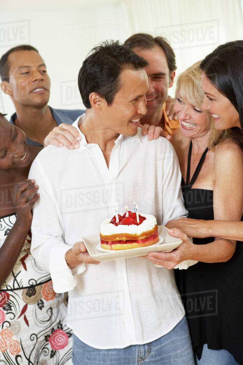 Friends Surprising Man With Birthday Cake