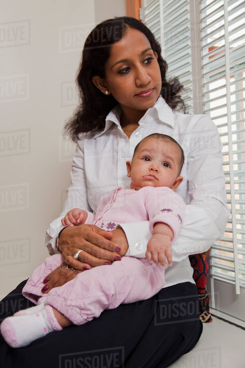 Indian mother holding baby stock photo