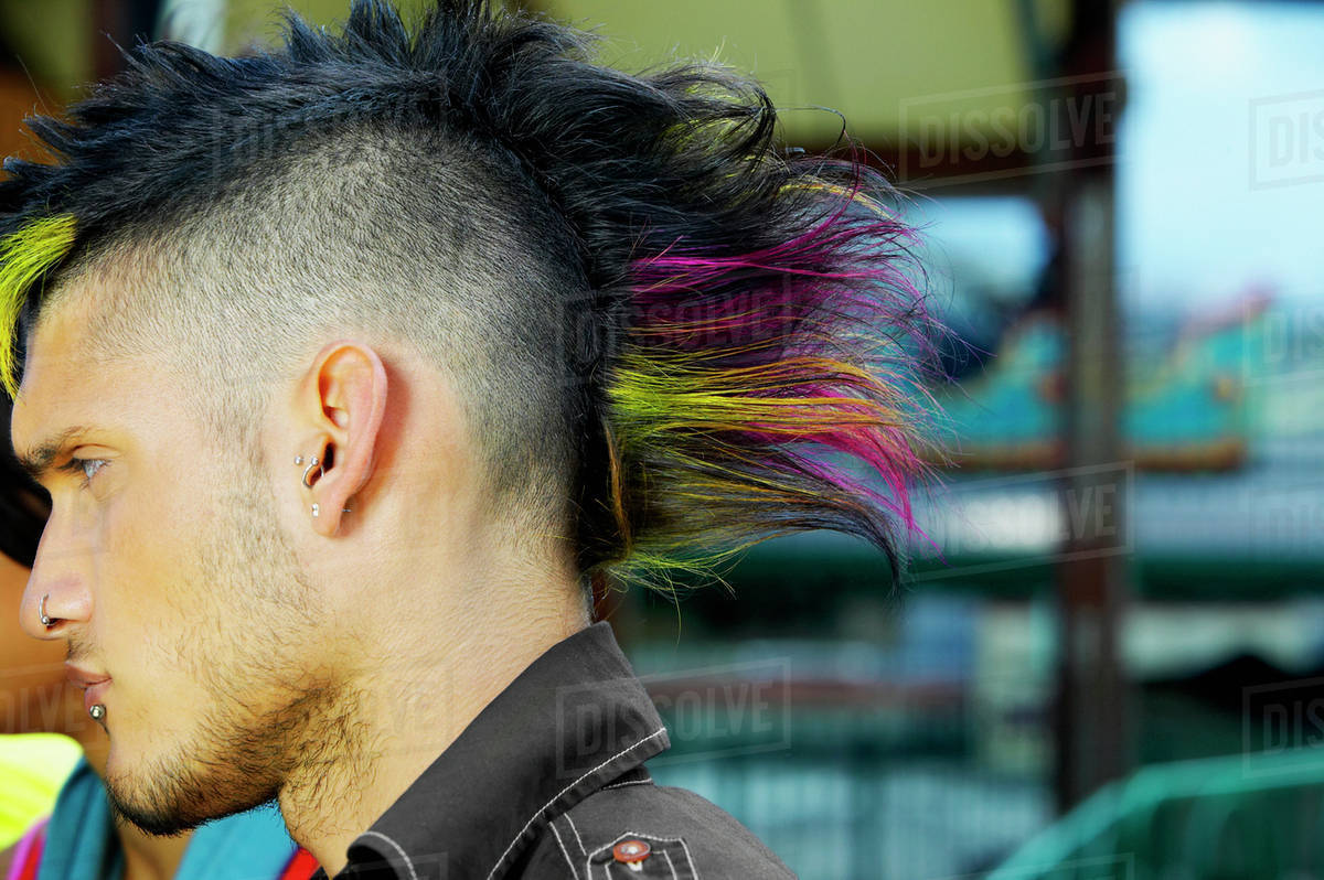 Profile Of Hispanic Male Punk With Mohawk Hairstyle Outdoors Stock