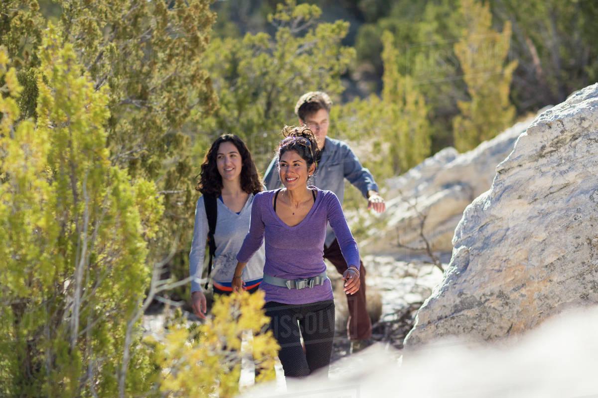 Hikers climbing rocky hillside Royalty-free stock photo