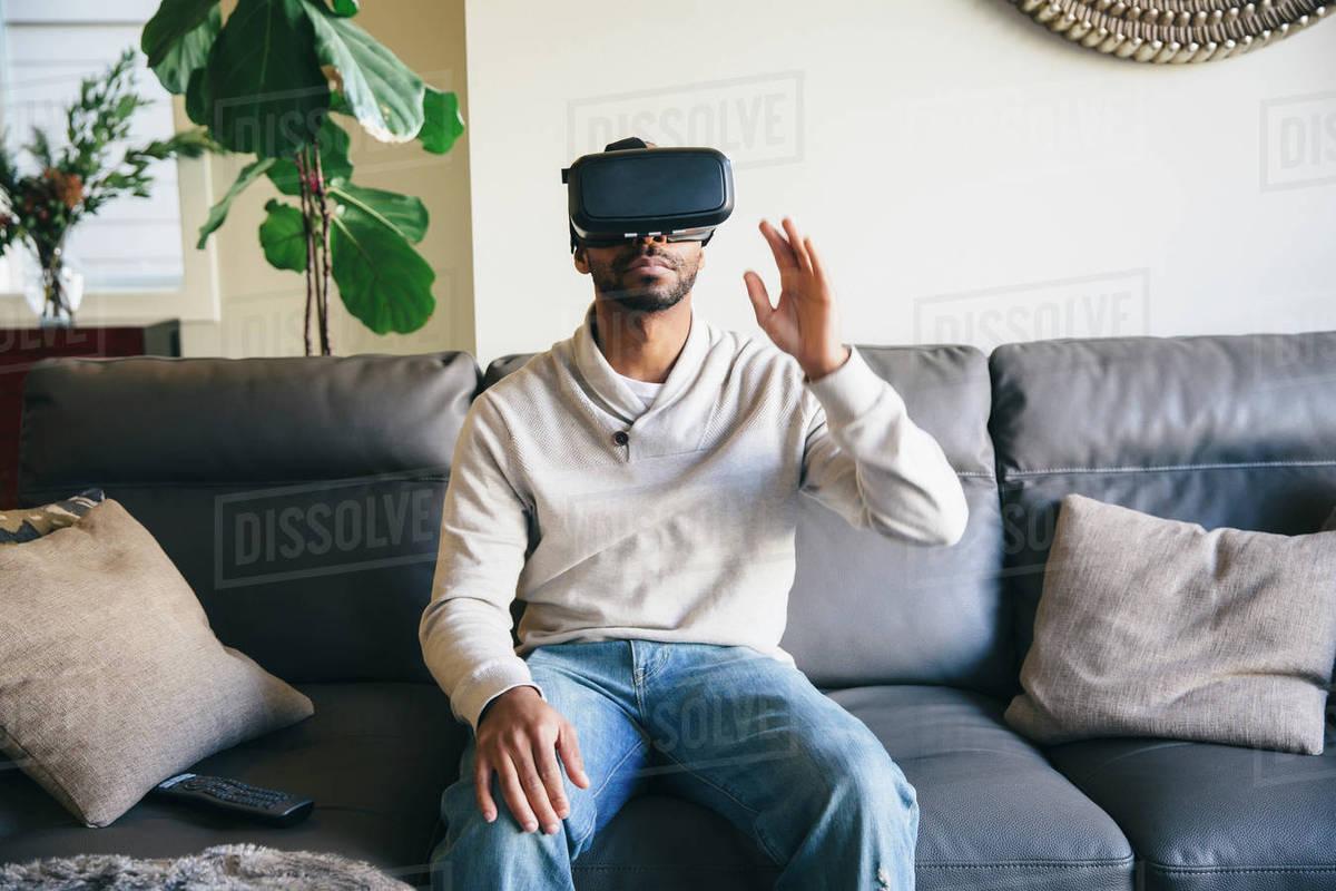 Mixed race man using virtual reality goggles Royalty-free stock photo
