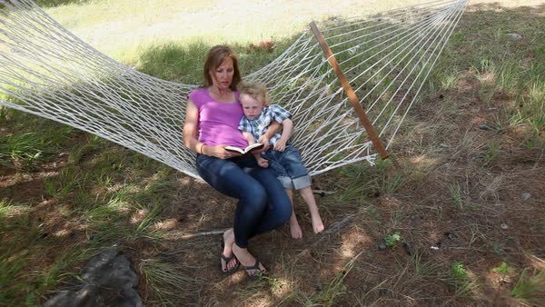 Mother and son reading in hammock Royalty-free stock video
