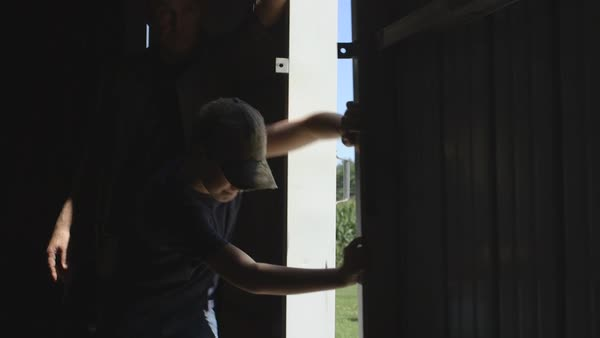 Father and son opening barn door Royalty-free stock video