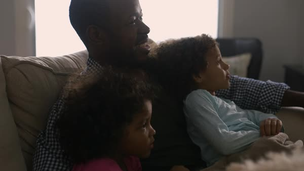 Father and daughter watching television on sofa Royalty-free stock video