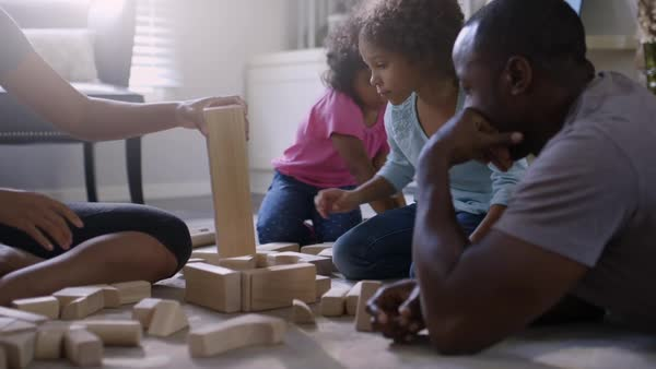 Family playing with building blocks in living room Royalty-free stock video