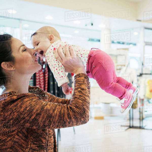 Caucasian mother and baby daughter shopping in store Royalty-free stock photo