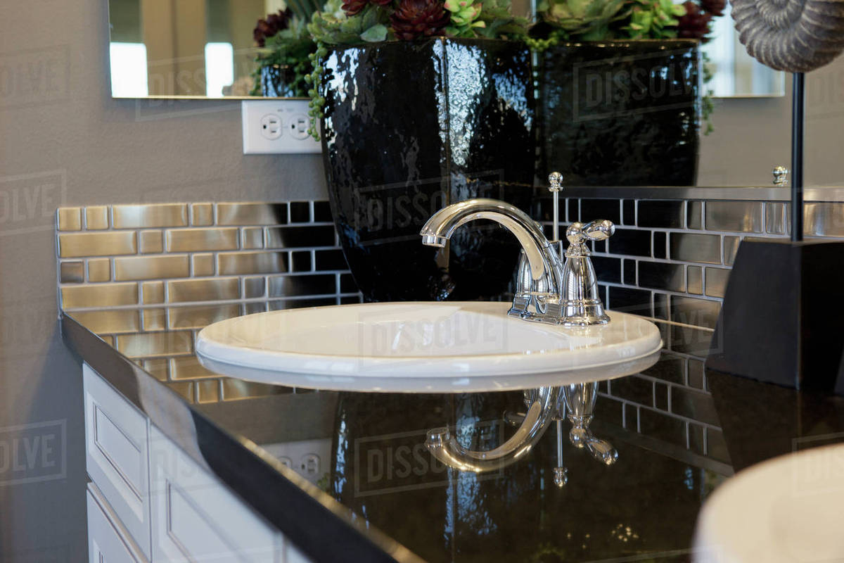 - Bathroom Sink With Metallic Backsplash - Stock Photo - Dissolve