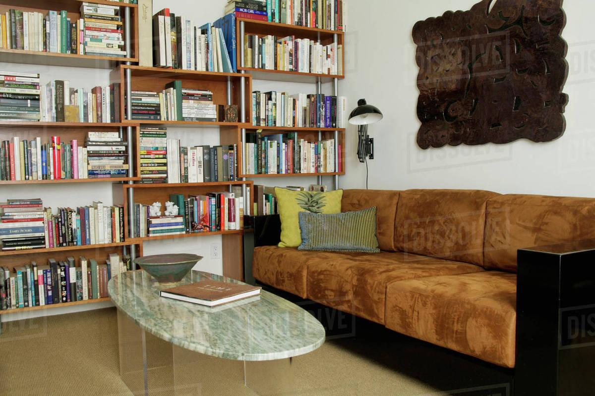 Brown suede sofa in den stock photo