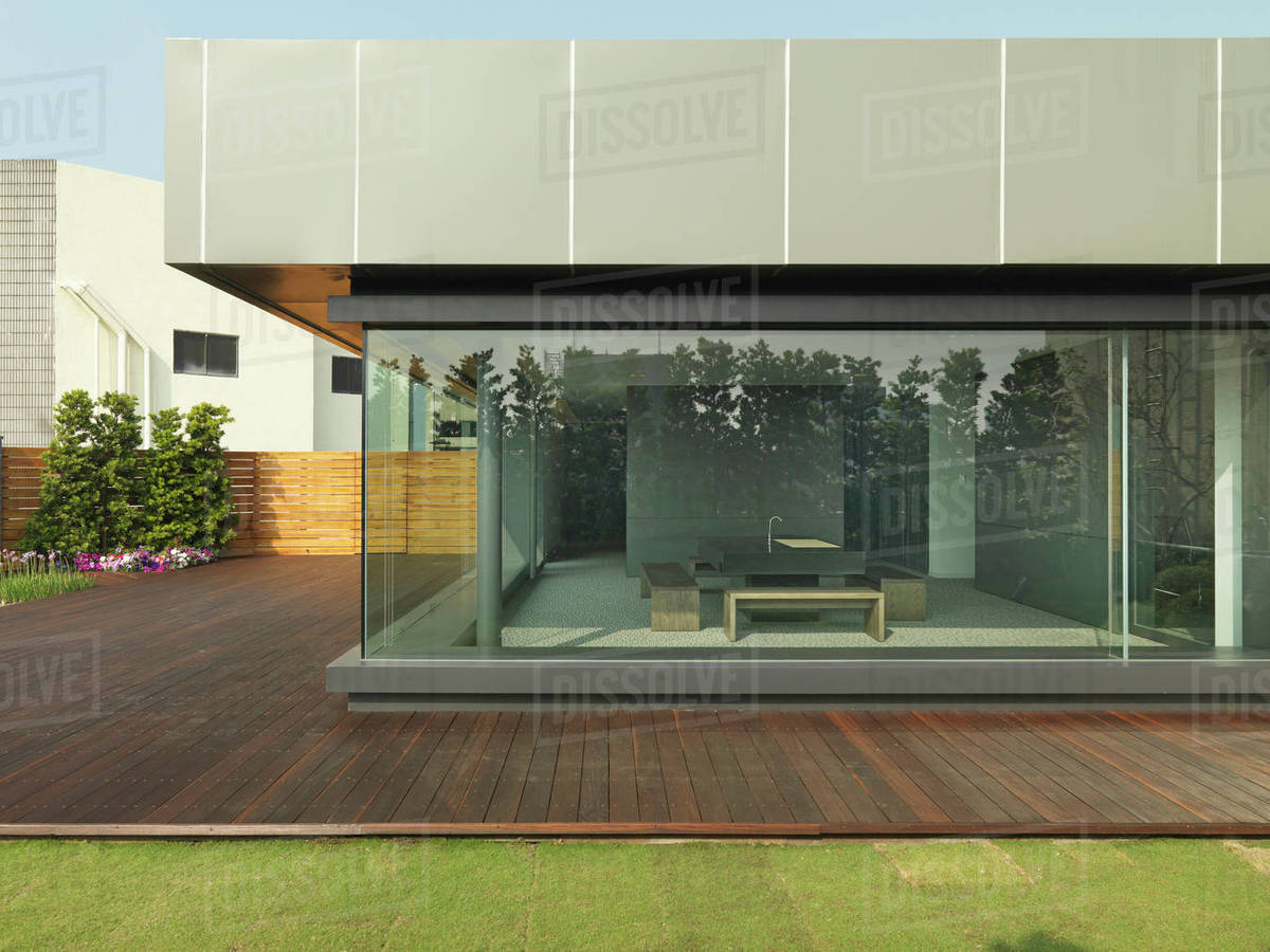 Exterior Of Modern Office Building With View Of Kitchen Through Glass Wall Stock Photo Dissolve
