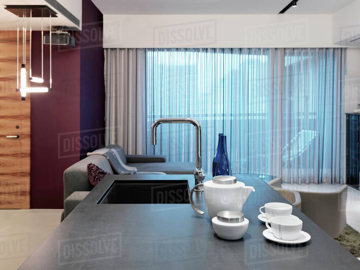 View down kitchen island to living room - Stock Photo - Dissolve