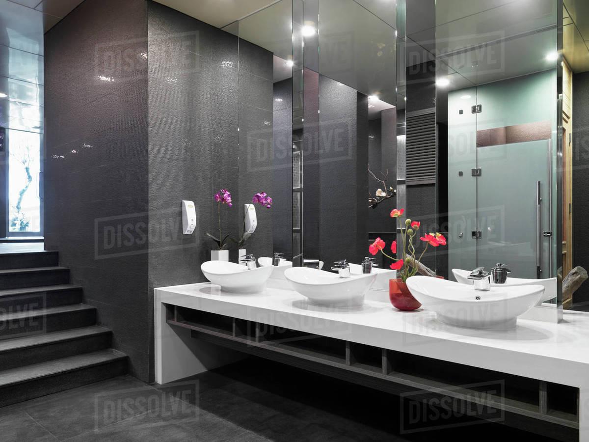 Row Of Bowl Sinks In Modern Bathroom Stock Photo Dissolve