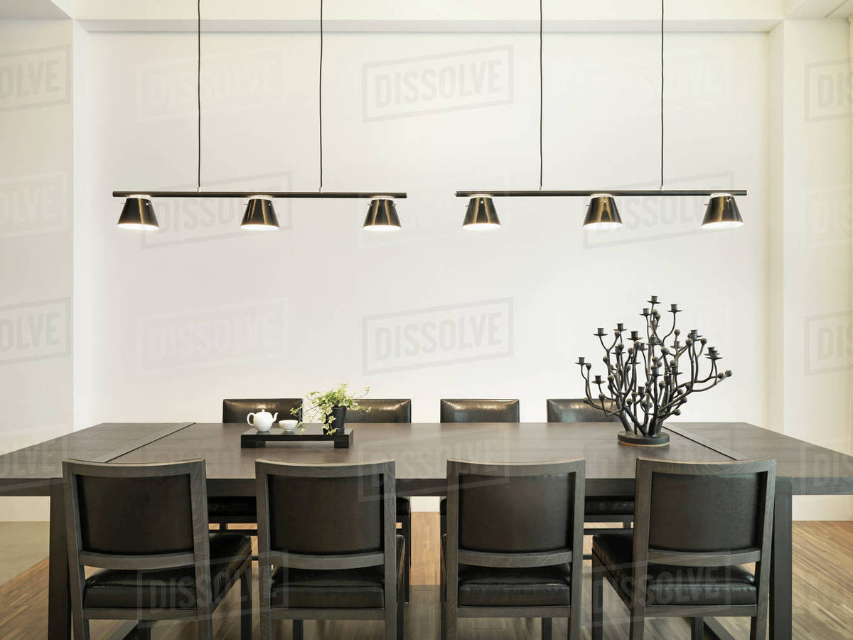 Simple Dining Table In Modern Home With Hanging Lights