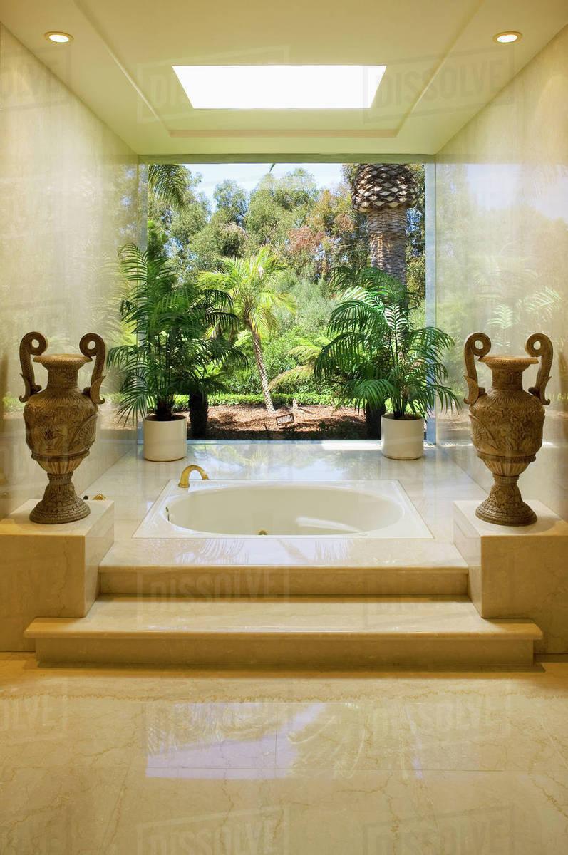 Marble steps leading to an elegant hot tub bathtub - Stock Photo ...