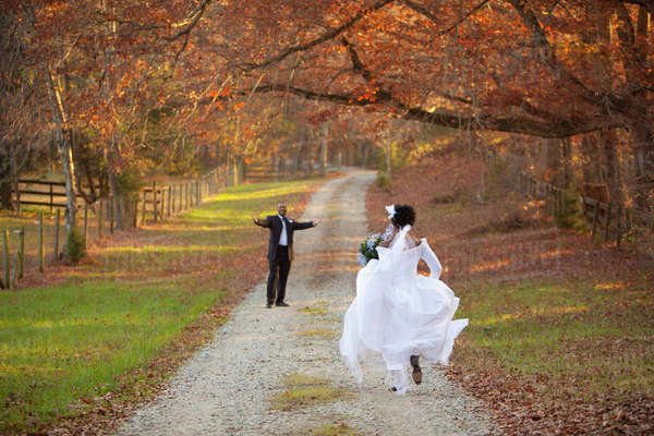 Bride and groom running to each other on path Royalty-free stock photo