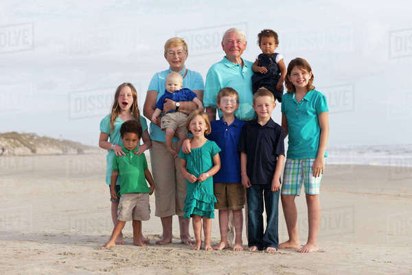Happy multi-generation family enjoying beach together Royalty-free stock photo
