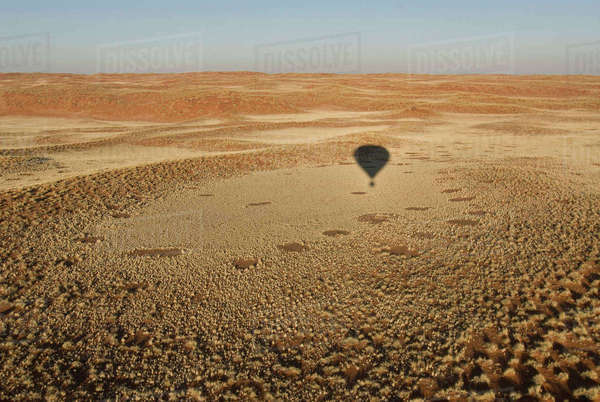Shadow of hot air balloon over desert Royalty-free stock photo