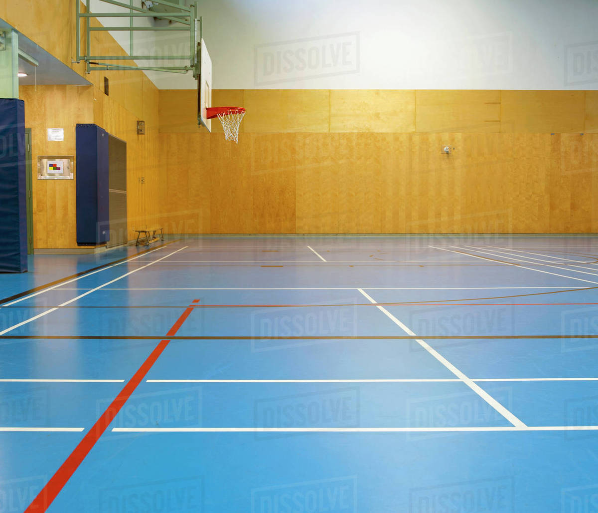 Empty indoor basketball court - Stock Photo - Dissolve