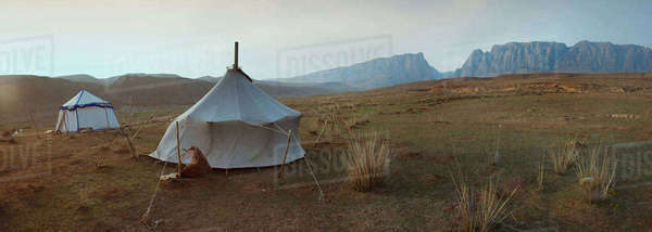 Two traditional yurts on a flat plain Royalty-free stock photo