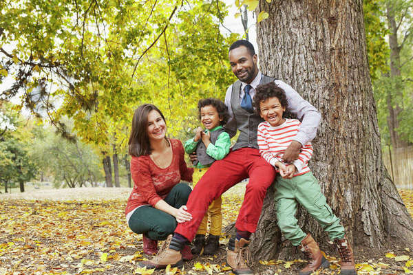Family smiling together in park Royalty-free stock photo