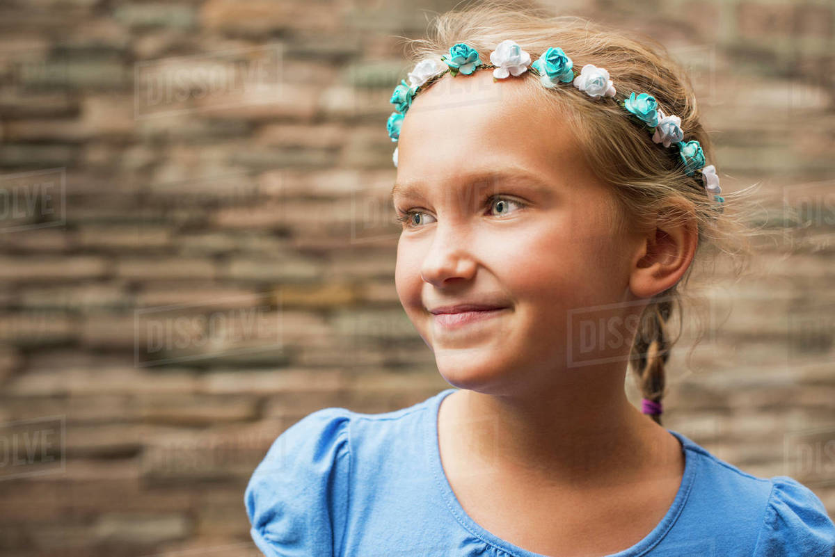 6cea099937 Smiling Caucasian girl wearing flower crown - Stock Photo - Dissolve