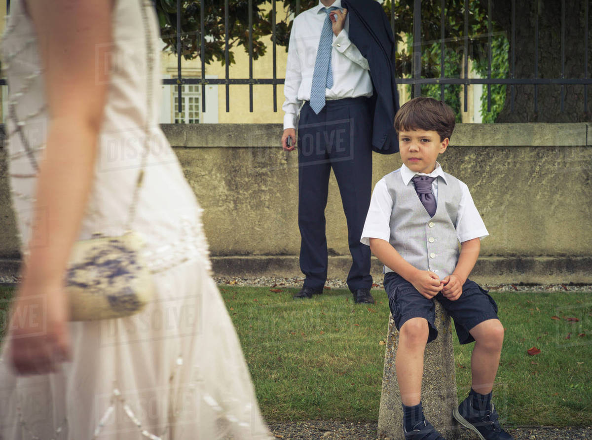 Bored Boy Wearing Formal Clothing At Event Stock Photo Dissolve