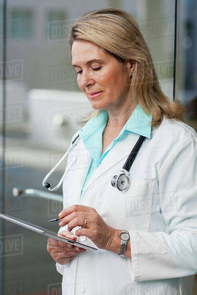 Caucasian doctor using digital tablet in hospital Royalty-free stock photo