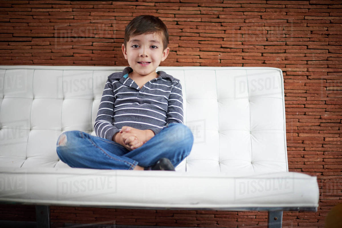 Excited lad in sofa