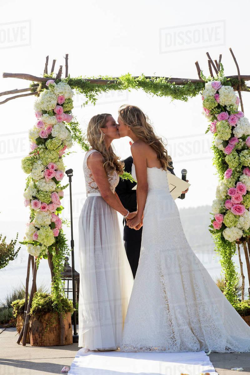 Brides Kissing At Wedding Ceremony