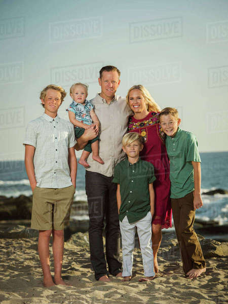 Caucasian family posing on beach Royalty-free stock photo
