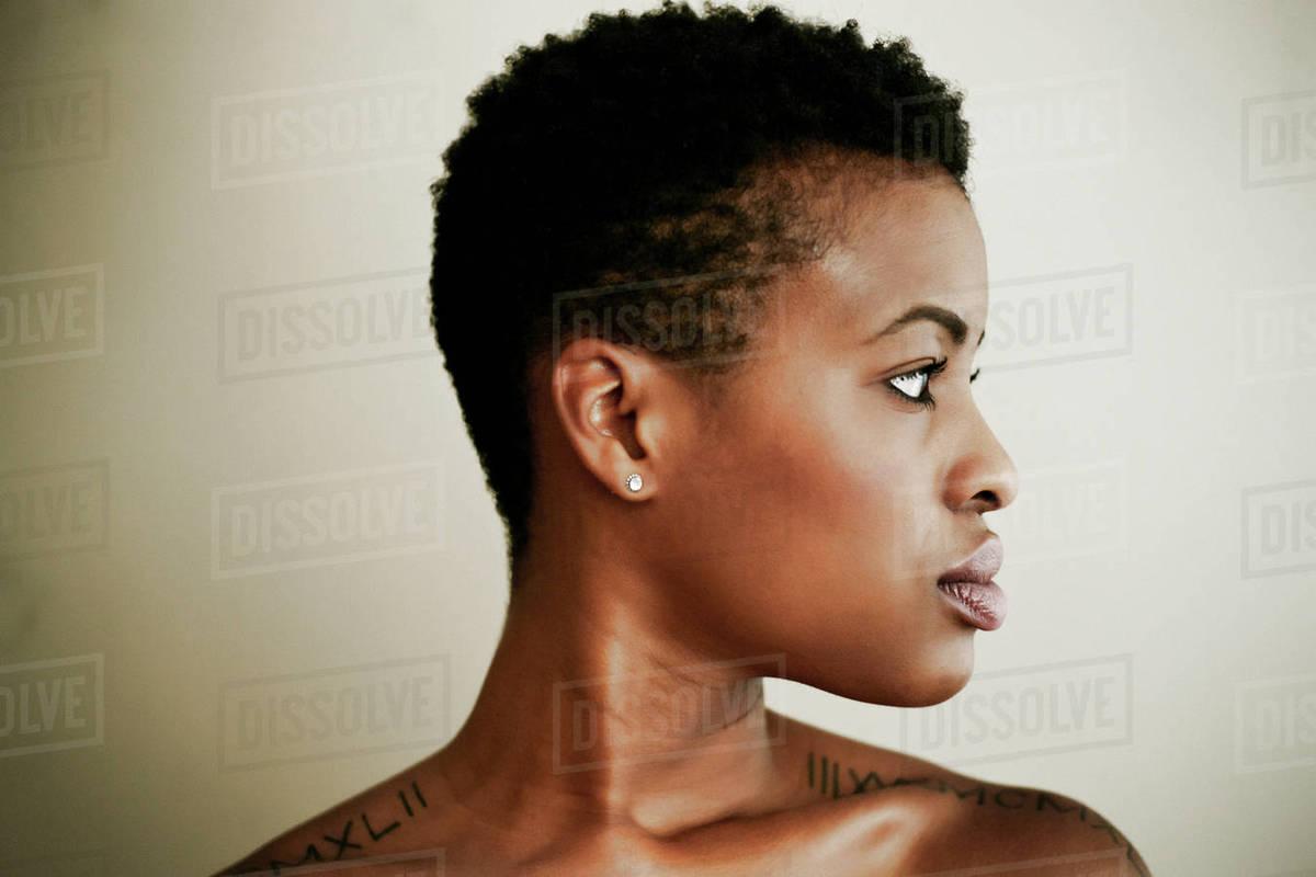 profile of serious black woman stock photo dissolve