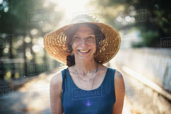 Smiling Caucasian woman wearing sun hat Royalty-free stock photo