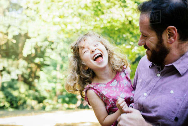 Father carrying laughing, daughter Royalty-free stock photo
