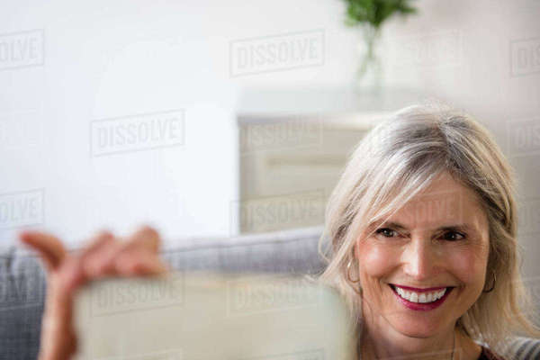 Smiling woman posing for cell phone selfie Royalty-free stock photo