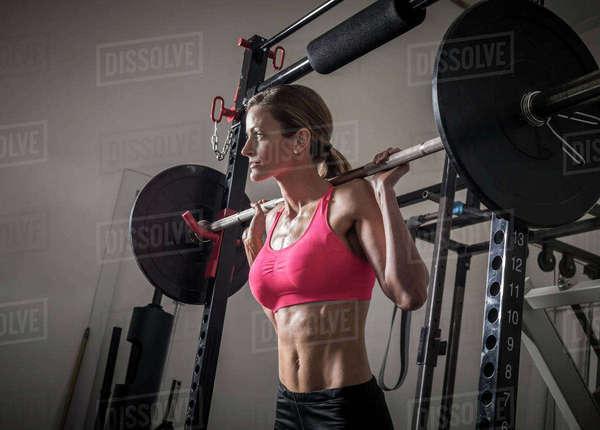 Naked Muscular Mixed Race Woman Lifting Kettlebells -2874