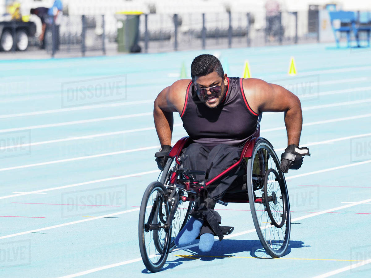 Fantastic Middle Eastern Man Racing In Wheelchair On Track Stock Photo Download Free Architecture Designs Scobabritishbridgeorg