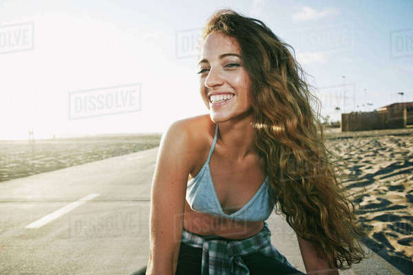 Portrait of woman smiling on path at beach Royalty-free stock photo