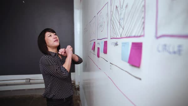 Asian businesswoman explaining whiteboard at meeting Royalty-free stock video