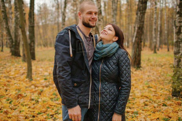 Middle Eastern couple standing in park in autumn Royalty-free stock photo