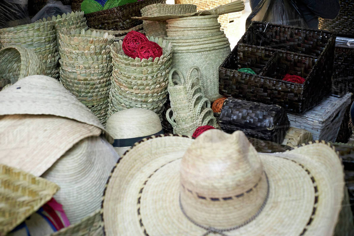Baskets and cowboy hats in store - Stock Photo - Dissolve f8488ceda75