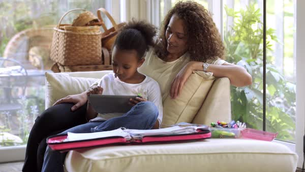 Mother watching daughter using digital tablet Royalty-free stock video