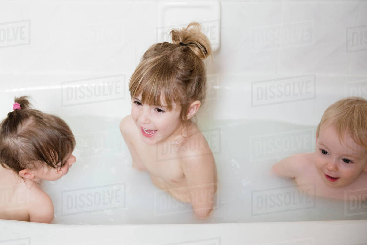 Smiling Caucasian Boy And Girls In Bathtub