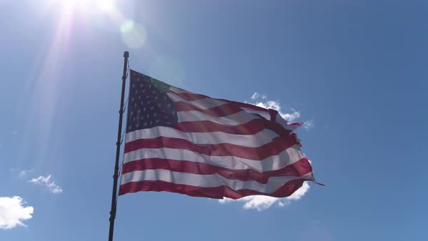 American flag blowing in the wind in sunny sky Royalty-free stock video