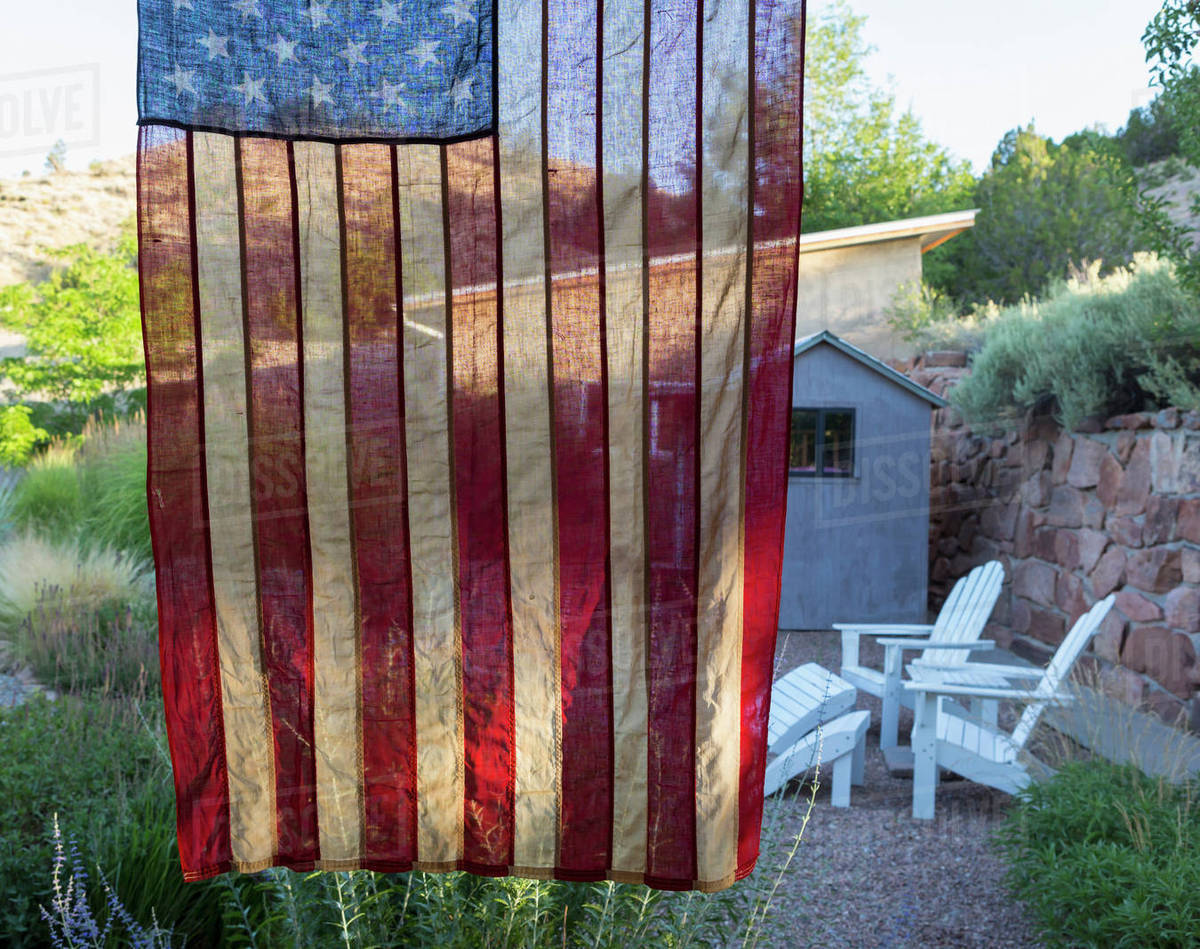 American Flag Hanging Near House Stock Photo Dissolve