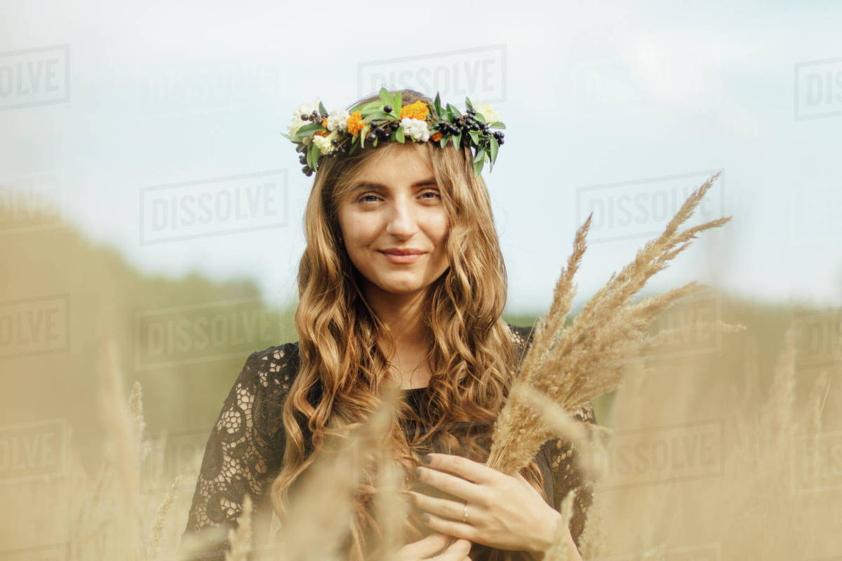 Middle eastern woman wearing flower crown holding wheat stock middle eastern woman wearing flower crown holding wheat izmirmasajfo
