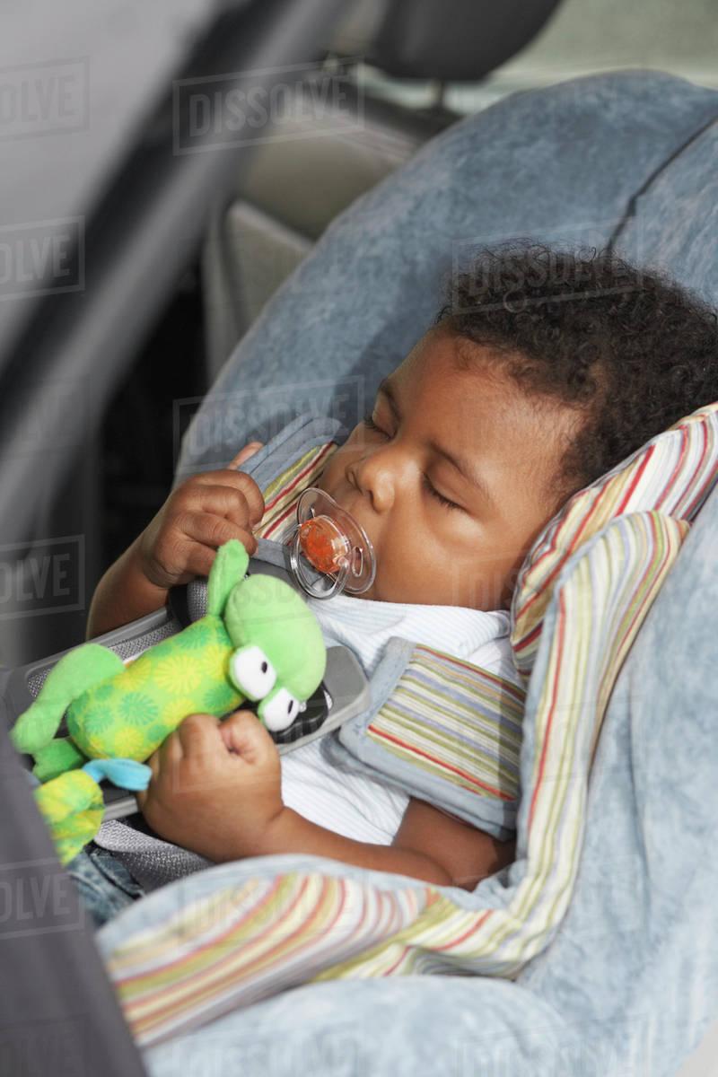 Black Baby Sleeping In Car Seat