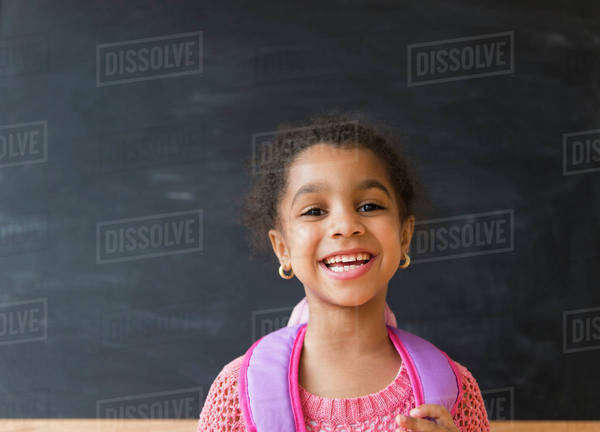 African American girl smiling in classroom Royalty-free stock photo