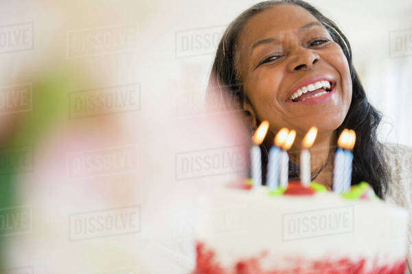 Mixed race woman celebrating birthday Royalty-free stock photo