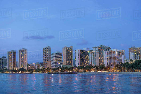 Illuminated city skyline on waterfront, Honolulu, Hawaii, United States Royalty-free stock photo
